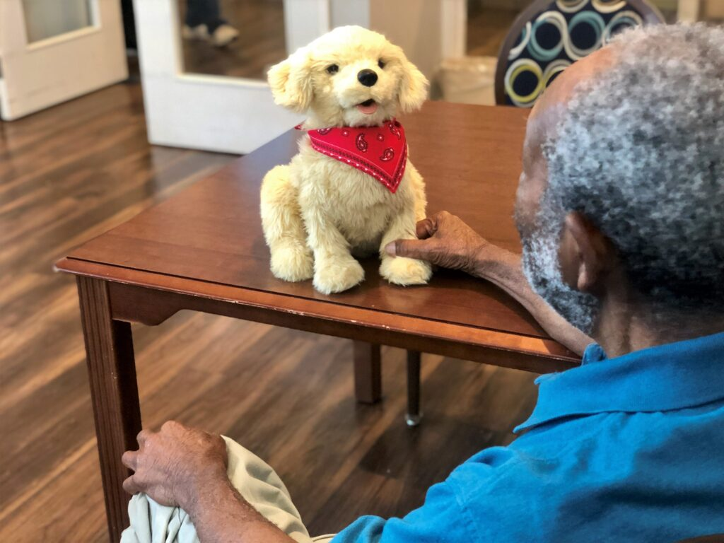 Residents enjoy interacting with robotic companion pets and therapy animals at Summer_s Landing Vidalia